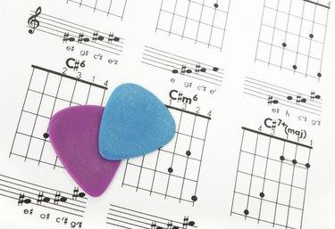 Guitar picks on a chords chart
