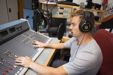 Handsome focused radio host moderating