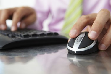 Close up man using keyboard and mouse