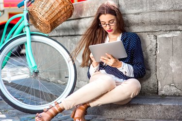 Business woman reading with tablet