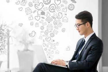 Young asian businessman using tablet, social media