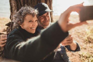 Senior couple at campsite taking selfie