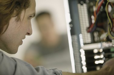 Computer technician concentrating