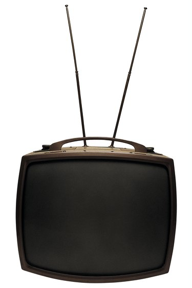 Old-fashioned television with antenna
