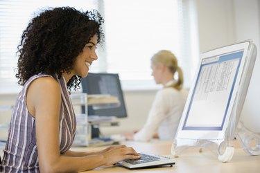 Businesswomen working at desks