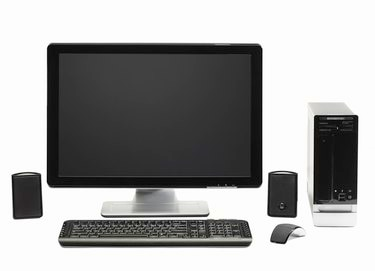 Computer with flat screen keyboard, speakers, mous