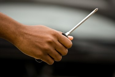 Hand holding screwdriver