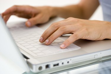 Woman's hands typing