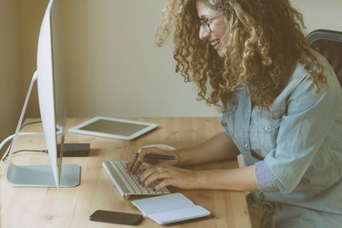 Young woman working at home or in a small office