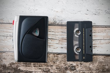 Old tape player, recorder and casette on wooden background