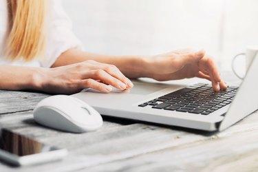 Ffemale hands on laptop keyboard