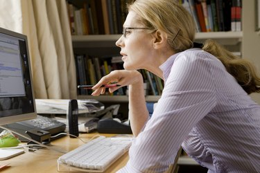 Woman studying computer screen
