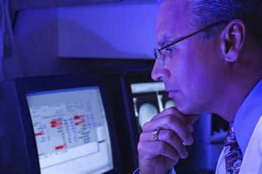 Technician using computer in laboratory