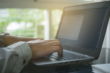 Close up hand type on keyboard labtop in home office