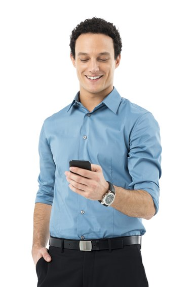 Businessman Texting On Cell Phone