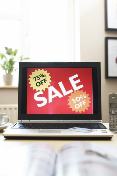 Sale advertisment on screen of laptop