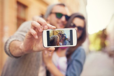 Young couple taking selfie in the city
