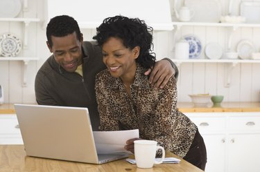 couple doing bills on computer