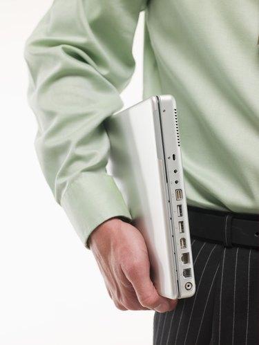 Man carrying laptop under arm
