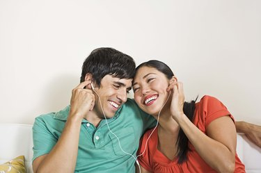 Couple sharing earphones
