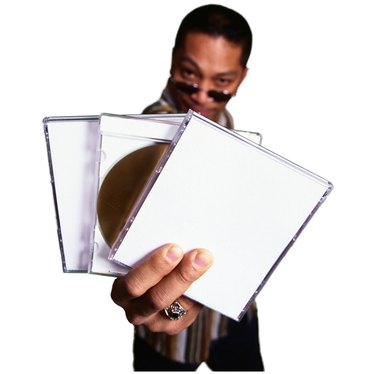 Man with CD and cases