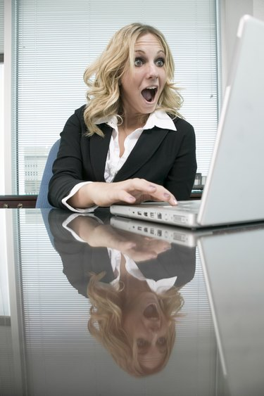Woman at desk using computer
