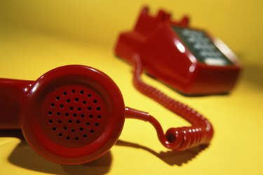 Close-up of a telephone receiver off the hook