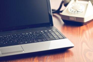 laptop and retro phone