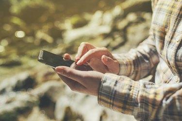Female tourist using mobile smart phone for GPS navigation