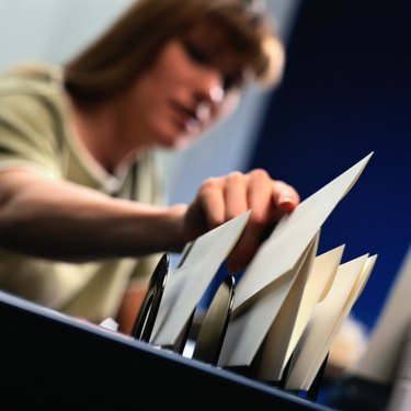 Woman Filing Letter