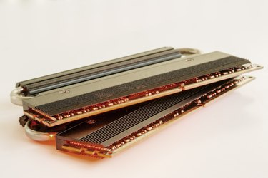 Two Sticks of RAM with a Red Glow