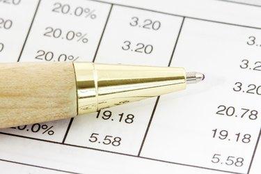 Pen on the financial spreadsheet