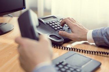 businessman dialing phone