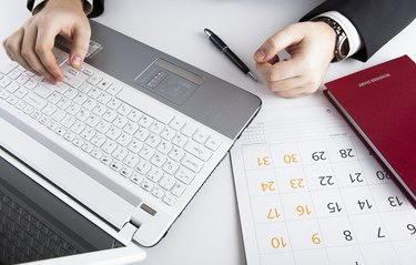human hands on the notebook keyboard