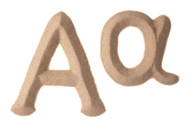 Alpha sign written with sand