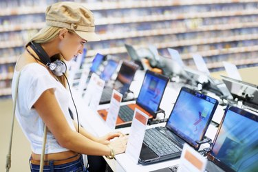 Pretty lady in retail computer store