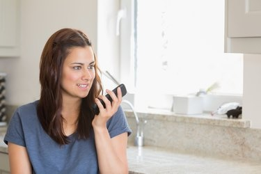 Brunette calling with her smartphone