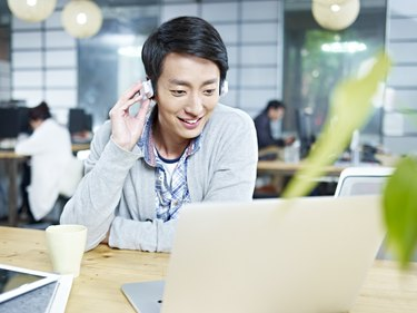 young asian designer working in office
