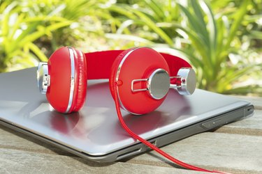 Vivid red headphones and laptop