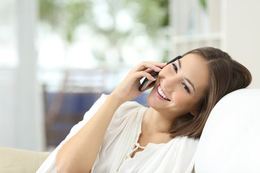 Girl talking on the mobile phone at home