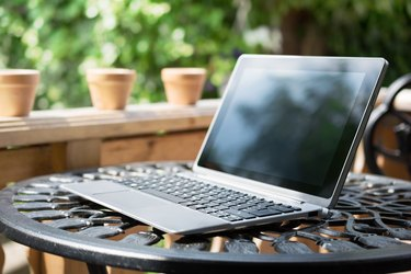 Notebook / Business Tablet With Keyboard Standing On Table Outside