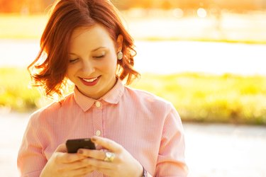 Young woman using a smartphone outdoors