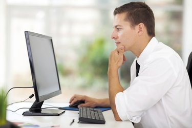 young businessman looking at computer screen