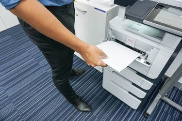 businessman print document