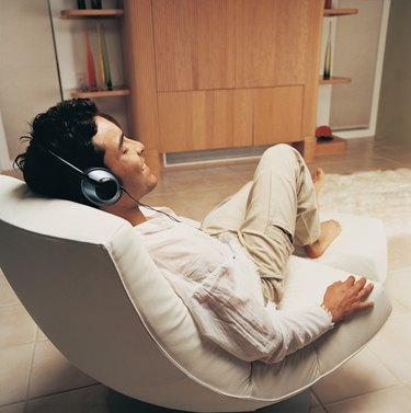 Man Relaxing to Music in His Sitting Room