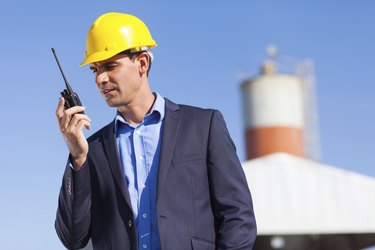 construction manager using walkie talkie