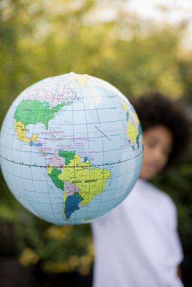 Boy holding globe