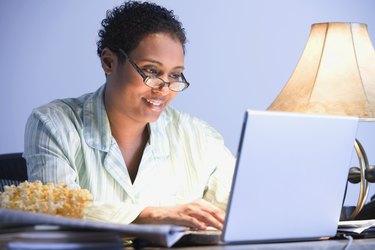 African businesswoman working in pajamas