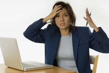 Extremely frustrated businesswoman with laptop