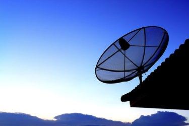 Satellite TV with sunset sky